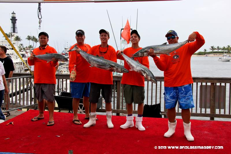 Saltwater Slam - Team Tito's Handmade Vodka weighing kingfish caught with Sceptre rods on our Yellowfin